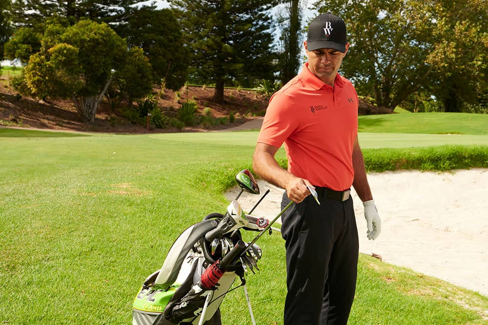 golf pro selecting wedge